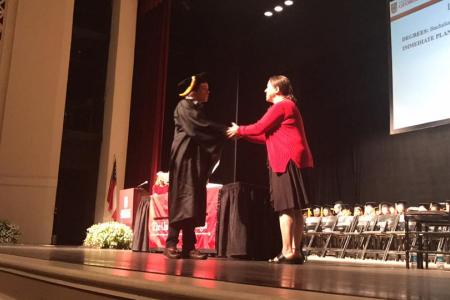 Graduate shaking hands with Director